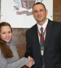 Christine Burke is congratulated by Jr./Sr. High School Principal Aaron Johnson for being recognized as a Commended Student in the 2014 National Merit Scholarship Program.