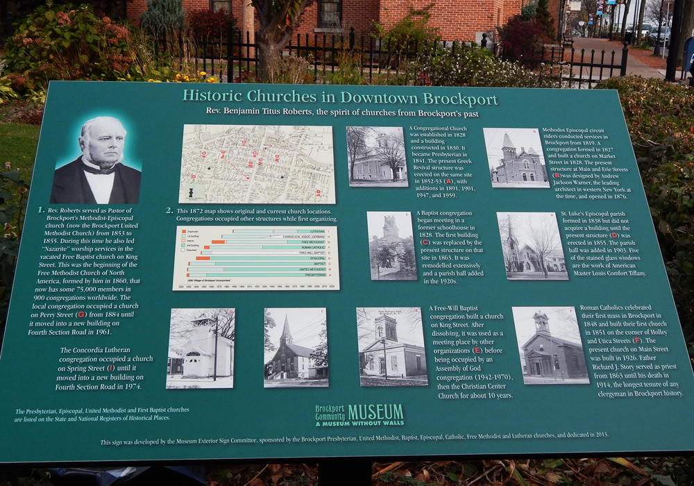 "The interpretive panel, three feet by two feet, entitled ""Historic Churches in Downtown Brockport"" stands in Sagawa Park. It features photos of historic church buildings, a time line of each church's development, and a walking map locating the churches. Rev. Benjamin Titus Roberts is also pictured, founder of the Free Methodist Church of North America beginning in Brockport in 1860."