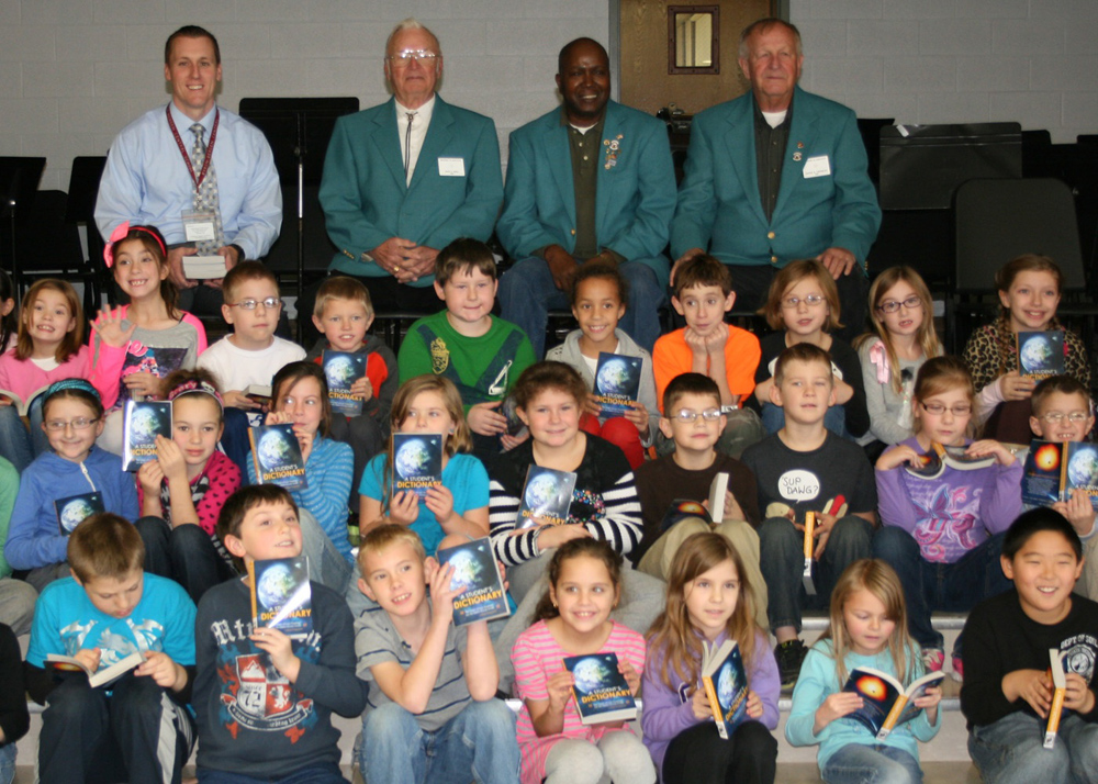 Byron-Bergen third graders show off their new dictionaries, supplied by the Brockport Elks Lodge. The event, promoting reading and literacy, was hosted by (back, l-r) Elementary School Principal, Brian Meister who welcomed Elks representatives Jack Hall, Glendale Terry and Dave Crowley.