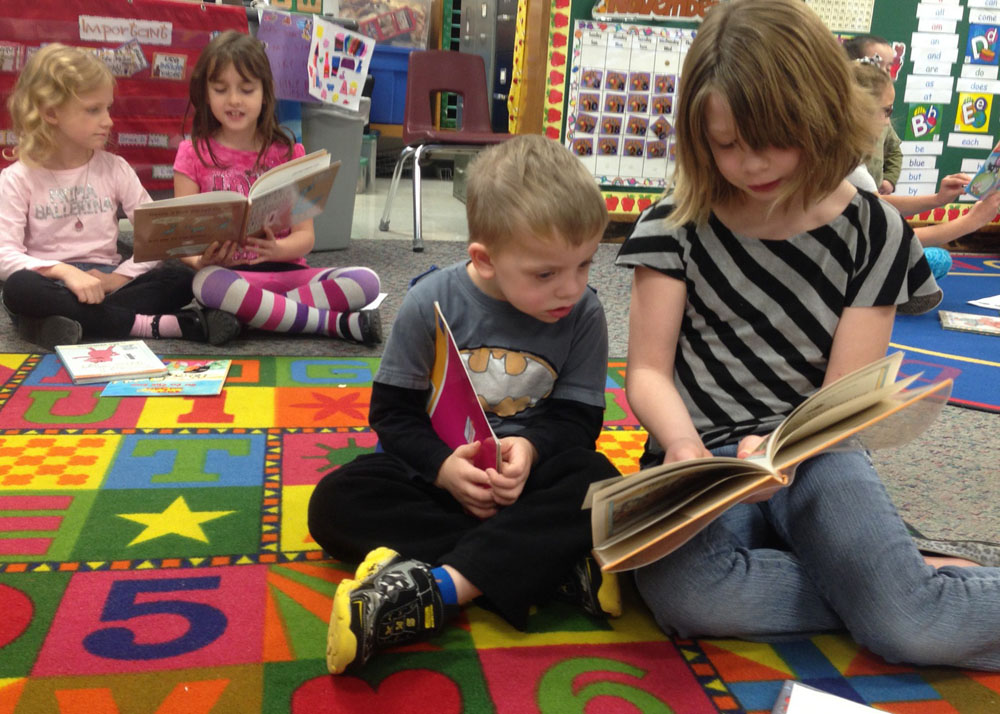 Byron-Bergen Elementary School students participate in the Celebration of Reading, a school-wide event that fosters and celebrates the love of reading with fun activities and challenges. Here, experienced older readers share their love for favorite stories with enthusiastic beginners.