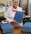 Local historian Eunice Chesnut in her office in the Morgan-Manning House with copies of the newly-published Encyclopedia of Brockport, Volume Two ready for sale.