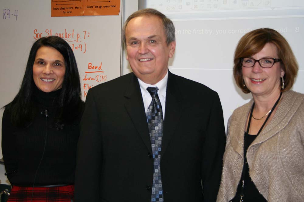 From left, Holley Elementary School teacher Lynn Vendetti, Senator George Maziarz and teacher's aide Maureen Christian. The Senator visited Holley Elementary to experience classroom learning using new SMART Board® technology.
