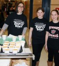 Liz Thornton, a social worker at Northwood Elementary School (left),  and students Grace Czebatol and Madilyn Rodas deliver cups of soup to people who participated in the Empty Bowls Project by donating $5 for a handmade bowl and a simple meal of soup and bread.