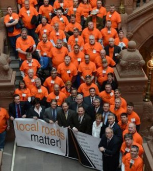 State lawmakers, highway superintendents and highway workers in the State Capitol.