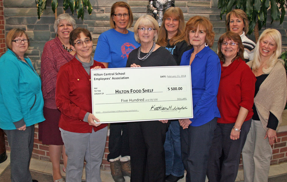 (Front, l-r) Tina Zebulske from the Hilton Food Shelf; and Hilton School-Related Professionals Kathy Najder, Molly Jardas, Marlene Smith and Heidi Barrett; (back) Lynda Donovan, Karen Jones, JoAnn Kruizenga, Eileen Hagen and Julie Norris.