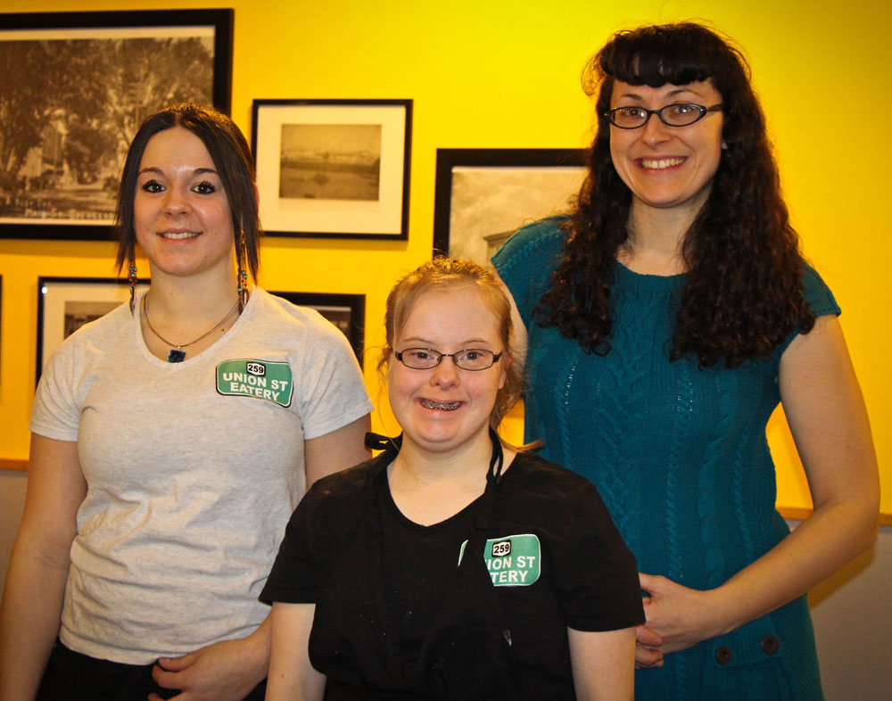 Julianne Warren (center) is joined at Union Street Eatery in Spencerport by server Kari Fennessy (left) and her job coach Lauren Seaver (right).