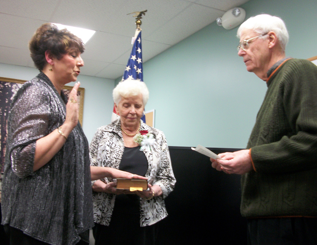 Newly elected Bergen Mayor, Anna Marie Barclay, was sworn-in by Genesee County Legislator Robert Bausch in a ceremony April 5. To Anna Marie's left is her mother, Elsie Scotto shown holding the Bible. Barclay is the first woman mayor in the history of the village.