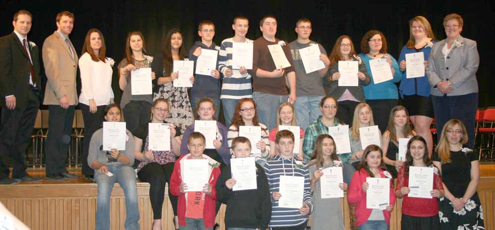 New inductees of the National Junior Honor Society are shown here. Front from left, Zachery VanAmeron, Patrick Wolfe, Andrew Moseman, Abrianna Kruger, Shawna Lusk, Jocelyn Cervone and Mrs. Kristen Pelkey. Second row, Amanda Valerio, Briana Colucci, Emily Bibby, McKenzie Kill, Abigail Williams, Alexis Penna, Julia Smith and Madison Marsh. Back row, Elementary School Vice Principal Ashley John Grillo, MS/HS Assistant Principal Dan Courtney, Mrs. Colleen Milner, Anastasiya Yaroshchuk, Ericka Mendoza, Jeremy Crandall, William Lavender, Ethan Bibby, Jeffrey VanOrden, Kendra Quill, Melanie Norman, Angela Weaver and MS/HS Principal Sue Cory. Missing from photo, Gaje Papponetti.