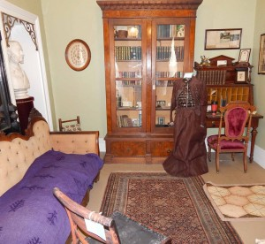 "The Mary Jane Holmes room contains a complete collection of her novels and several pieces of furniture from her very large home which she referred to as her ""Little Brown Cottage."""