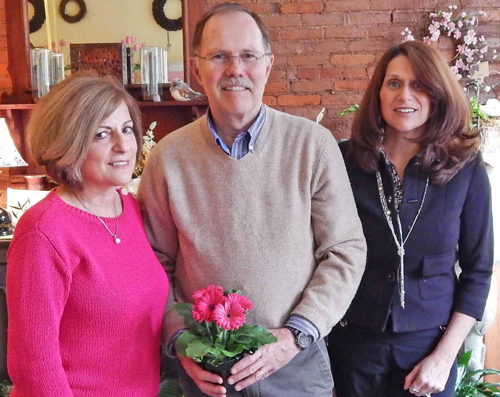 Lynn (left) and Don Short (center) stand with Allison Andrews in Arjuna Florist & Gifts on Main Street in Brockport. The Shorts will end 39 years as owners when Allison takes over on June 1.