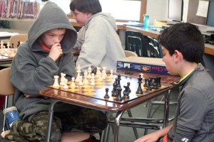 Fifth-grader Joey Oliver (left) contemplates his next move against Elijah Weider during the chess tournament.