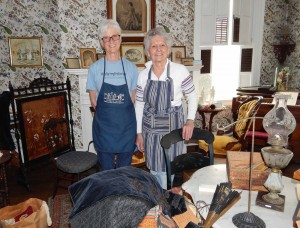 Deb Talley (left) and Sue Savard spent many hours organizing the Victorian Parlor in the Emily Knapp Museum.