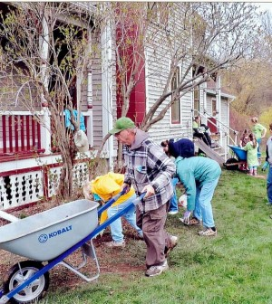 Volunteers and members of The Friends of Hamlin Beach State Park work on flower gardens at I Love My Park Day May 3.