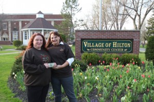 Cathy Carmestro congratulates Hilton Apple Fest logo design contest winner Kelly Cologgi.