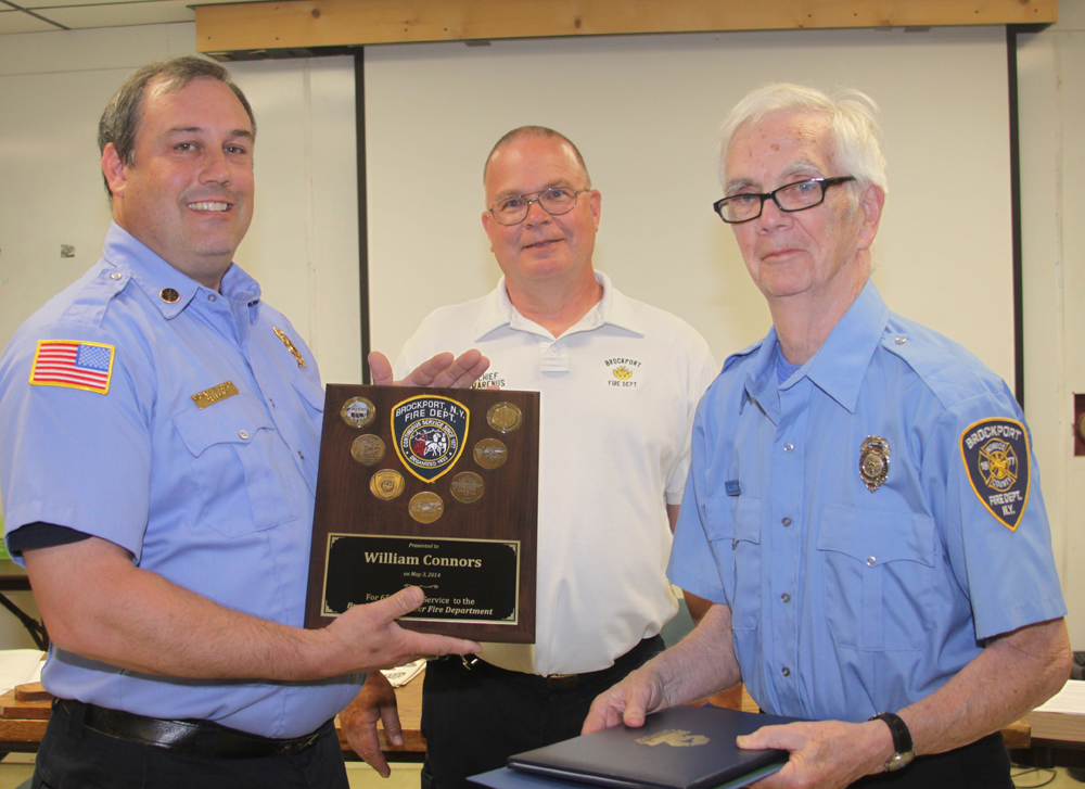 (Left to right) Association President Michael Corey, Fire Chief Don Marenus and Past Captain Williams Connors.