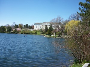 A view across Mirror Lake in Delaware Park in Buffalo looking at the Japanese Garden and the Buffalo History Museum.