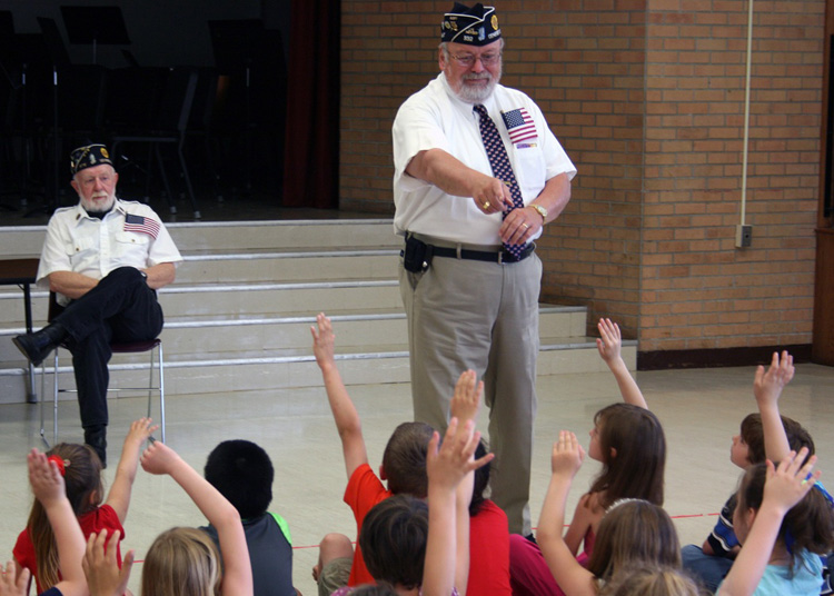 Genesee County American Legion Commander Dave Henry and Post & County Adjutant Jim Neider (l to r) find an enthusiastic audience for U. S. flag lore at Byron-Bergen Elementary School.