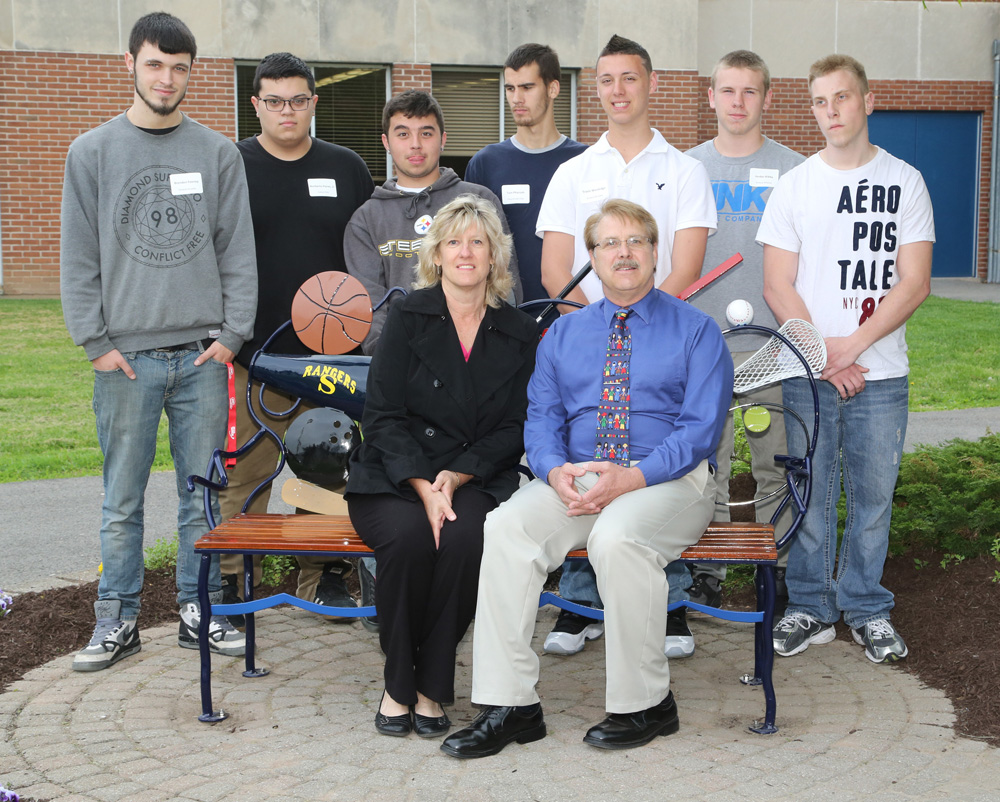 Rob's parents, Bill and Donna Stultz of Spencerport with students from Monroe 2 BOCES in the WEMOCO Auto Collision and Repair Technology class.