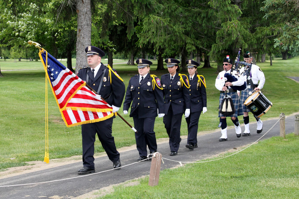 The Honor Guard and members of the Gates Police Keystone Club march along the paths of a local golf course as part of the opening ceremonies of a fundraiser for fallen emergency personnel. Firefighters from across Monroe County and the northeast region gathered for a two-day tournament to pay tribute to the fallen heroes from New York State, raise funds for the National Fallen Firefighters Foundation, play some golf and enjoy the brotherhood that fighting fires fosters, according to organizers.