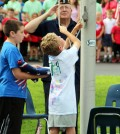 A member of the American Legion Hiscock Fishbaugh Post 788 salutes as Ryan Russell (left) and Mason Mashiotta post the colors during the Flag Day Ceremony at Northwood Elementary School.