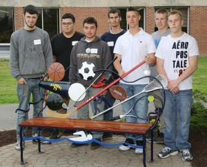 The new bench was unveiled during a ceremony on May 29 by students (l to r) Brenden Feeney - Greece Arcadia; Norberto Flores, Jr. - Gates Chili; Jonathan Bullers - Churchville-Chili;  Tom Pharoah - Churchville-Chili; Travis Wooledge - Greece Arcadia; Jordan Kibby - Greece Athena; Christian Davey-Ruell - Hilton High School.
