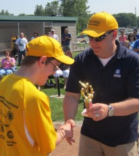 Cody Sands receives his trophy from Coach Steve Noyes.