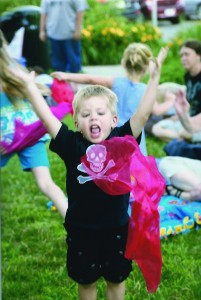 "Easton Webster, 2, from Brockport, reacts to Sue's directive: ""Toss your scarf into the air!"""