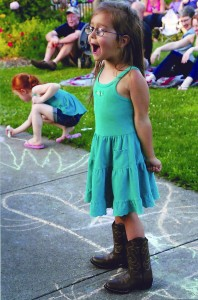 MacKenzie Sarges, 3, from Brockport, put her heart and soul into singing along.