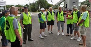 WBB Volunteers await bikers at the Main Street Bridge, Monday, July 14, left to right, Bill Andrews, Joe Blossenhauser, All Way, Ed Lehman, Harry Shifton, Rosie Rich, Alicia Fink, Ray Duncan and Merrill Melnick.