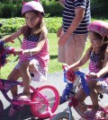 The patriotic theme was carried out in many ways at Morgan Manning's July 4 celebration. Bicycles and other similar vehicles of childhood were adorned in red, white and blue and their riders sported suitable and often matching attire.