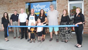 Antonio Valerie cuts the ribbon.