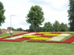 Workers in The Quilt Garden provide a sense of perspective to show the size of the design.