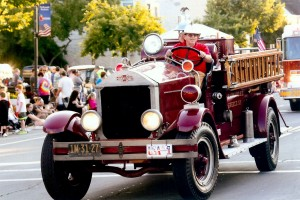The 1928 American LaFrance fire engine rolls on, courtesy of the Barnard FD in Greece. Photograph by Walter Horylev.