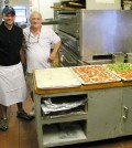 "Marciano ""Marcy"" Chinappi and his father, Joe, in the kitchen at Giuseppe's, with some of the pizzas that have helped make the business so famous."