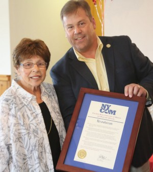 Honeoye Falls Mayor Rick Milne presented Joyce Lobene with a plaque from NYCOM, the New York Conference of Mayors and Municipal Officials, at a reception in Lobene's honor held July 31.