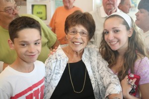 Sharing the recognition at the July 31 gathering were Joyce's grandchildren, Sam and Lauren Lobene.