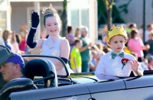 Jessica Williams and Nicholas Green, the Queen and King of the Hilton Firemen's 2014 Parade, wave to the crowd during the parade July 24. The Queen is 10; the King is 7. Photograph by Walter Horylev.