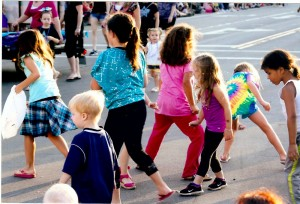 Children chasing down candy thrown by parade participants is an annual event at the parade. Photograph by Walter Horylev.