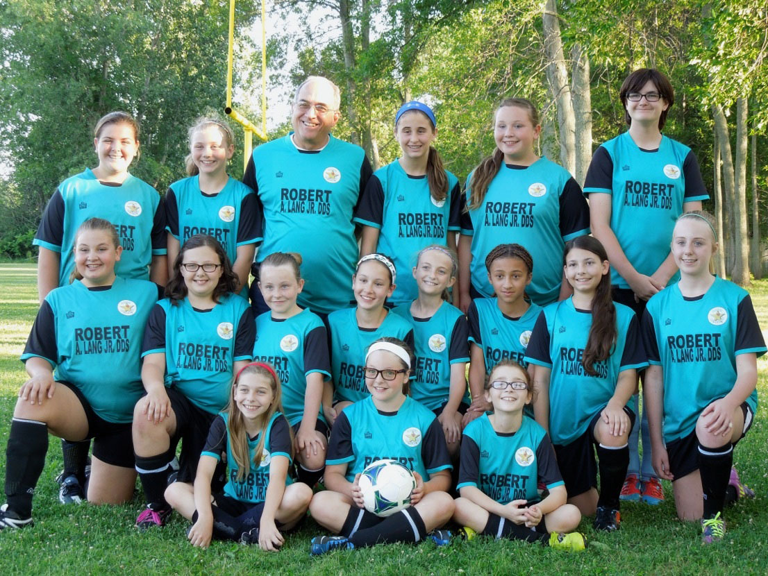 The 2014 Girls 10-12 Youth Hamlin Recreation Soccer Team with Coach Doug Kurz. Provided photo