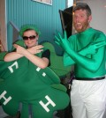 """Kid Clover,"" aka summer assistant Niki Wachob, on the left with 4-H Educator Robert Batt, sporting a clover-green bodysuit he agreed to wear if more than 35 new 4-H members signed up during Orleans County Fair week in late July. Batt said the total will likely top 40 new youth participants."
