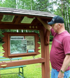 Marty  Howden checks out the information sign at the history trail. Provided photo