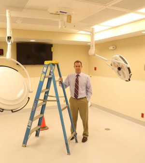 Bryan O'Donovan in the unfinished Operating Room 3; the IT equipment is already installed. This is one of three rooms in the Surgery Center.