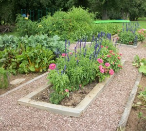 The vegetable garden demonstrates a more formal design.