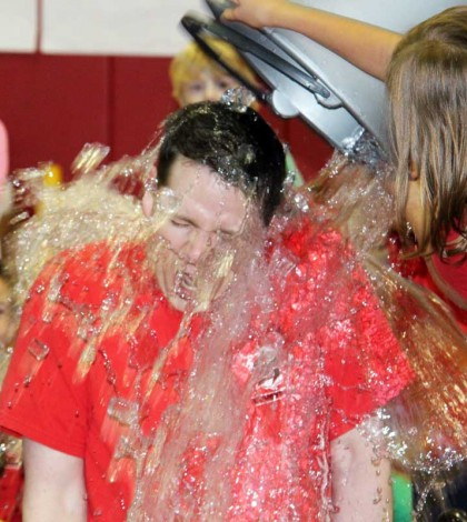 Brian Lumb, assistant principal at Village Elementary School in Hilton, takes the Ice Bucket Challenge to get students excited about responsible risk taking.