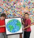 Northwood Elementary School students, Luca Dodge, left, grade four, and Jacob Soricone, grade six, display the fingerprint world picture and dot tree that students created after reading The Dot, by Peter H. Reynolds.