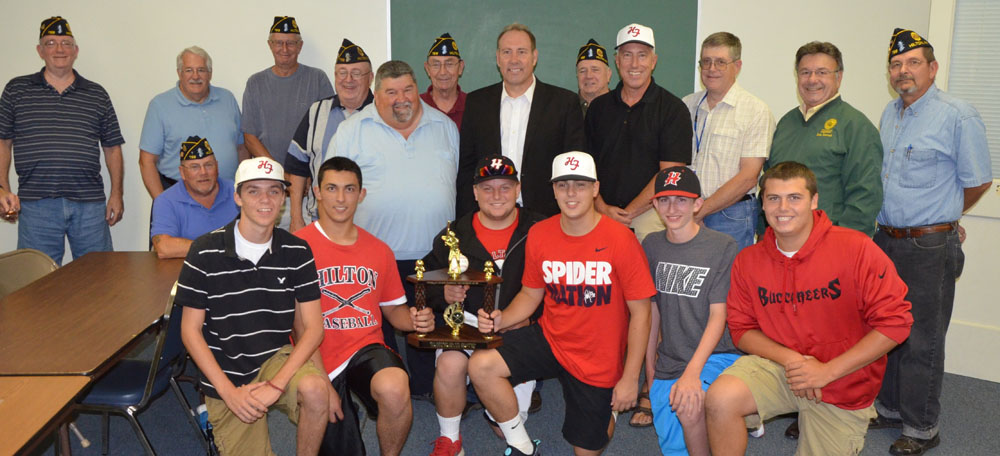Members of Hiscock-Fishbaugh American Legion Post 788 join Hilton Mayor Joe Lee, NYS Senator Joe Robach, Team Coach Daryl Wolf, Parma Supervisor Jim Smith, County Legislator Dick Yolevich and Post 788 Commander Dave Baun in congratulating the members of Post 788's American Legion Baseball team on their championship season. Hilton's team won the Monroe County championship with an 18-4 record - the first time in the team's 60+ year history. The team of 18 boys, all current or recently graduated from Hilton High School.