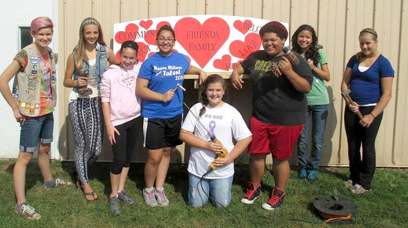 Girl Scout Cheyenne Zaremba (left) and Hamlin Royals members (l to r): Angelina Courtney, Allie Cring, Javiana Delgado, Gabriella Schleiter, Anastasia Brown, Ryanna VanDetta and Jade Cook.
