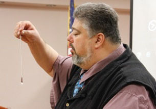 Ralph Esposito demonstrates how to use a crystal pendulum to communicate with the paranormal.