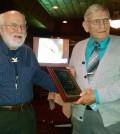 "Bergen Swamp Preservation Society Trustee Lee Drake, Sr., Bloomfield, NY (left) awards a ""Partner-in-Preservation"" award to Joseph Whitcomb, Newark, NY (right). Provided photo by Barb Drake."