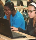 "(l-r) Brockport OMS eighth-graders Carey D'Andrea, working on the Angry Birds maze tutorial, and Yihah Soto, absorbed in coding to create ""Frozen"" ice patterns."